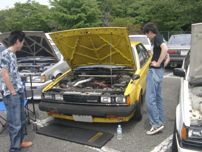 Yellow Carina TA63 sedan on second national Toyota Carina A60 & Corona T140 meeting on mount Fuji
