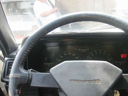 Toyota Carina GT-R AA63 for sale in Peru, dash is dirty and steering wheel worn