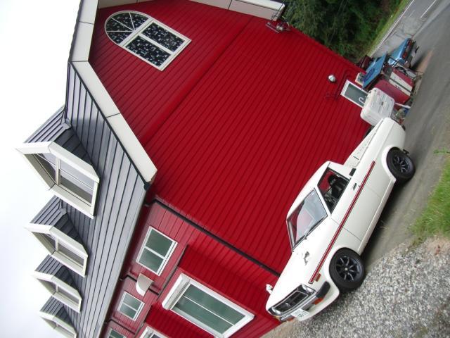 Toyota Corolla KE30 pickup in front of a European looking house