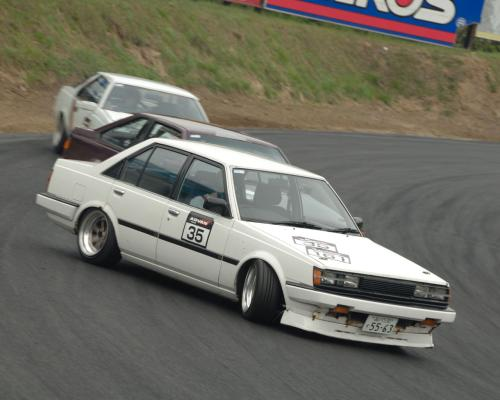 Previous background: AT140 coupe, AA63 sedan and AA63 coupe drifting