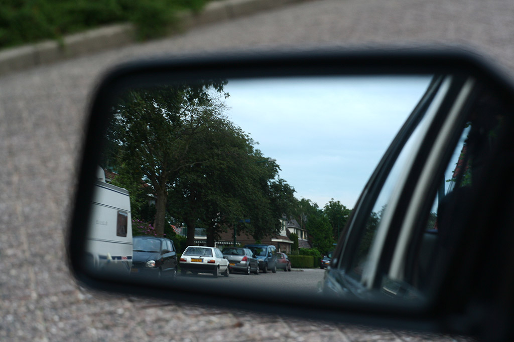 Toyota Corolla EE80 in rear view mirror
