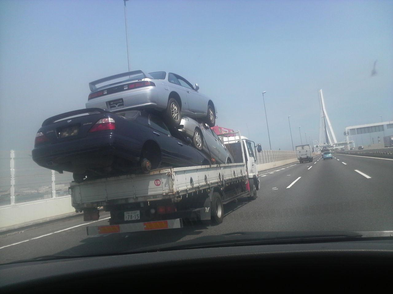 Flatbed hauling RWD Nissans