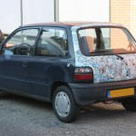 DOTS: Stickerbombed Suzuki Alto