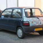 DOTS: Stickerbombed Suzuki Alto