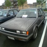 Carina Sightings: dark-grey panda Carina sedan
