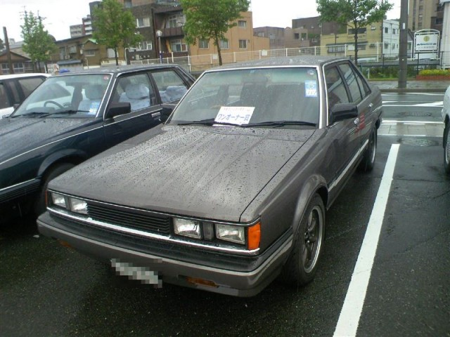 Dark grey Carina AA63 sedan