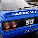 WTF: Exhaust pipe routed through Calsonic Nissan Skyline R31