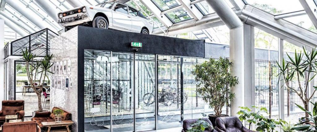 Datsun Cherry E10 on KN Jupiter rims inside an office building